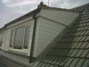 800px-concrete_tile_re-roof_with_upvc_dormer-300x225